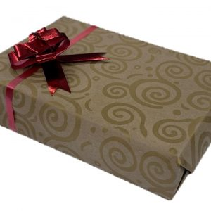 gold spiral patterned gift wrap with red bow